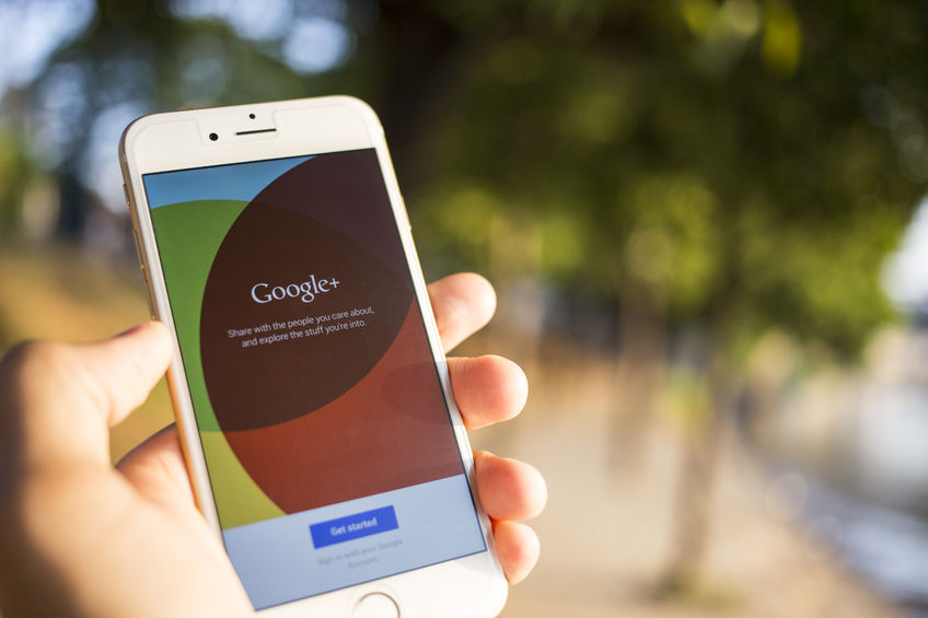 Hand holding a phone with Google+. Learn more about Google My Business and Dental Marketing from WEO Media