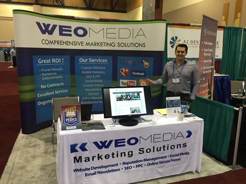 WEO Media booth with Joe Genco. He can connect you with an expert in local SEO for dentists.